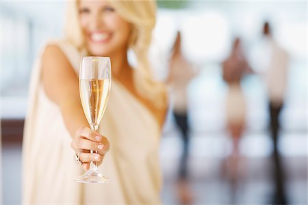 sparkling - Close up of woman holding champagne flute Stock Photo - Premium Royalty-Free, Code: 635-03860113