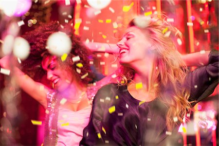 Friends dancing in nightclub Stock Photo - Premium Royalty-Free, Code: 635-03860120