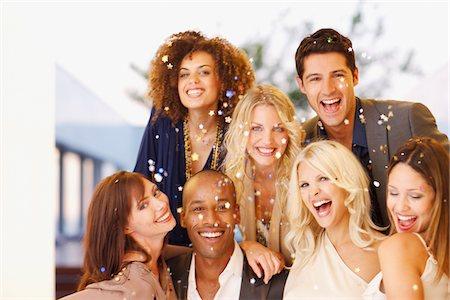 Confetti falling around friends Stock Photo - Premium Royalty-Free, Code: 635-03860121