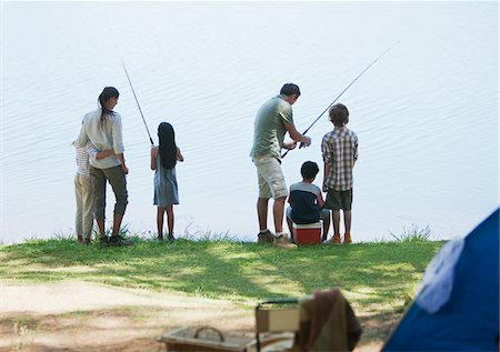 Family fishing near campsite Stock Photo - Premium Royalty-Free, Code: 635-03860175