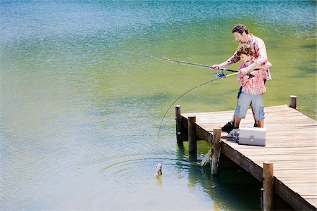 Father and son fishing off dock Stock Photo - Premium Royalty-Free, Code: 635-03860177