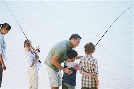 Family fishing in lake Stock Photo - Premium Royalty-Free, Code: 635-03860179