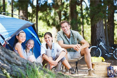 Family sitting outside tent at campsite Stock Photo - Premium Royalty-Free, Code: 635-03860195