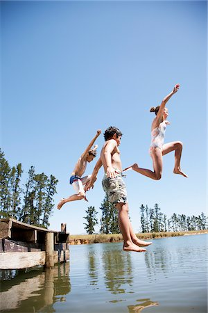 Kids jumping in lake Stock Photo - Premium Royalty-Free, Code: 635-03860191