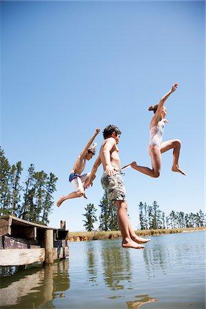Kids jumping in lake Stock Photo - Premium Royalty-Free, Code: 635-03860191