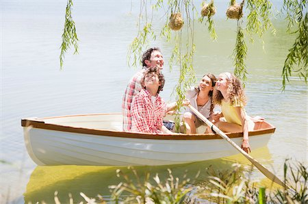 side view of person rowing in boat - Family in rowboat on lake Stock Photo - Premium Royalty-Free, Code: 635-03860208