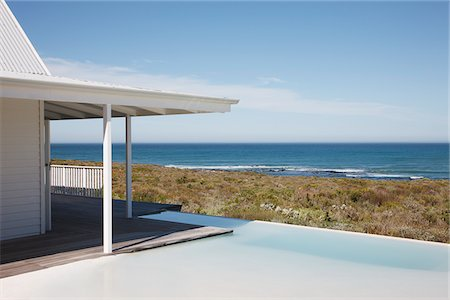 forever - Beach house and infinity pool overlooking ocean Stock Photo - Premium Royalty-Free, Code: 635-03860218