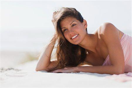 Woman laying on beach Stock Photo - Premium Royalty-Free, Code: 635-03860269