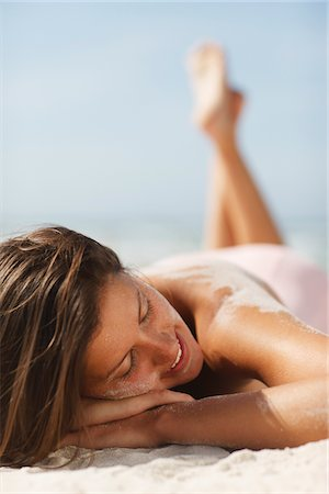 pretty - Woman sunbathing on beach Stock Photo - Premium Royalty-Free, Code: 635-03860288