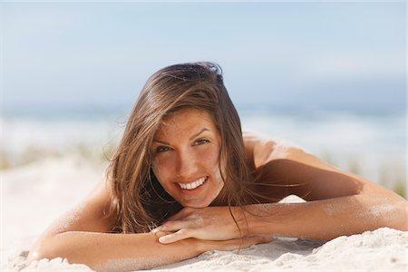 Woman laying on beach Stock Photo - Premium Royalty-Free, Code: 635-03860293
