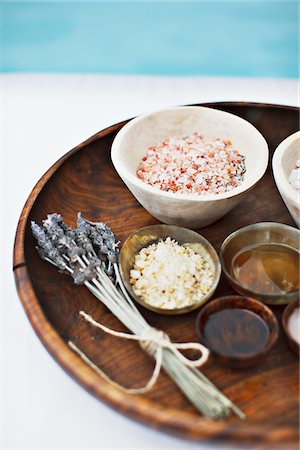 Bath salts and massage oils in bowls on tray Stock Photo - Premium Royalty-Free, Code: 635-03860324