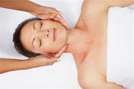 facial - Woman receiving facial massage Stock Photo - Premium Royalty-Free, Code: 635-03860415