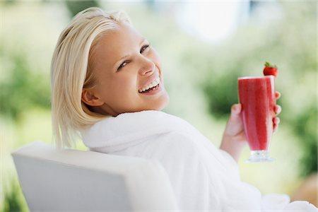 Woman in bathrobe drinking smoothie Stock Photo - Premium Royalty-Free, Code: 635-03860424