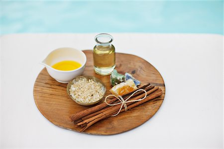 Bath salts and massage oils at poolside Stock Photo - Premium Royalty-Free, Code: 635-03860420