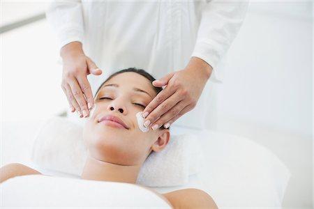 facial - Woman receiving facial Stock Photo - Premium Royalty-Free, Code: 635-03860430
