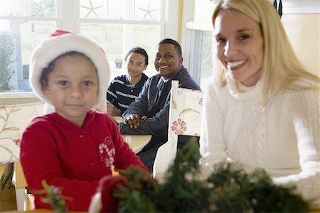 Interracial family at Christmas Stock Photo - Premium Royalty-Free, Code: 638-01334585