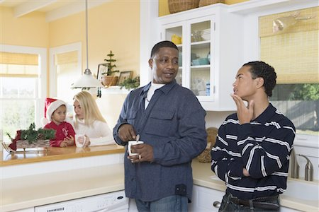 An inter-racial family in the kitchen Stock Photo - Premium Royalty-Free, Code: 638-01332215