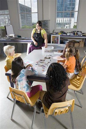 draw black women - An art teacher teaching young students in art class Stock Photo - Premium Royalty-Free, Code: 638-01333009