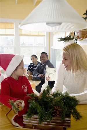 Interracial family at Christmas Stock Photo - Premium Royalty-Free, Code: 638-01333039