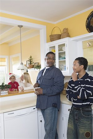 An inter-racial family in the kitchen Stock Photo - Premium Royalty-Free, Code: 638-01333278