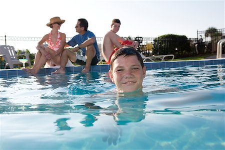 family fun day background - Family vacation at a swimming pool Stock Photo - Premium Royalty-Free, Code: 638-01584047