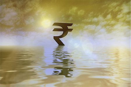 Indian rupee symbol floating on water Stock Photo - Premium Royalty-Free, Code: 630-06724358