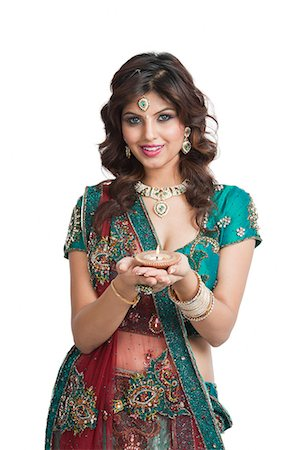 Woman holding an oil lamp on Diwali Stock Photo - Premium Royalty-Free, Code: 630-06724470