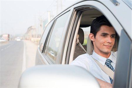 east indian (male) - Businessman driving a car, Gurgaon, Haryana, India Stock Photo - Premium Royalty-Free, Code: 630-06724633
