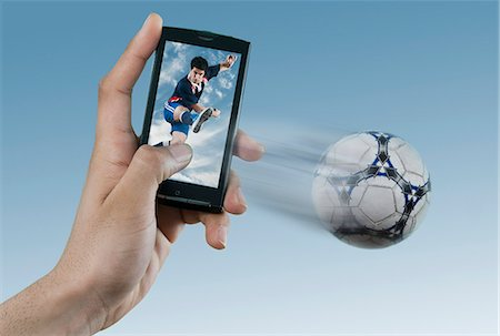 streaming - Person watching soccer game on a mobile phone Stock Photo - Premium Royalty-Free, Code: 630-06724641