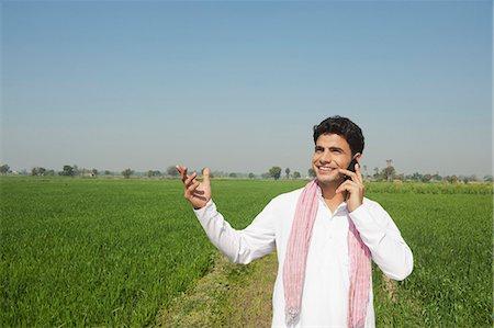farm phone - Farmer talking on a mobile phone in the field, Sonipat, Haryana, India Stock Photo - Premium Royalty-Free, Code: 630-06724653