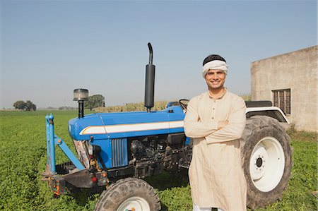 Farmer standing near a tractor in the field, Sonipat, Haryana, India Stock Photo - Premium Royalty-Free, Code: 630-06724670