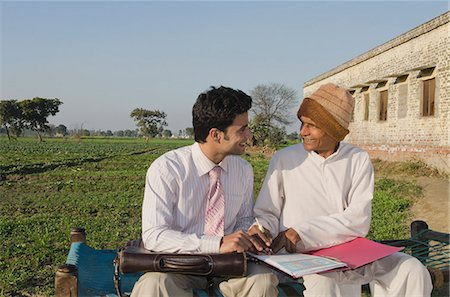 Farmer signing on the agreement of agriculture loan, Sonipat, Haryana, India Stock Photo - Premium Royalty-Free, Code: 630-06724697