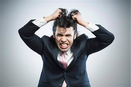 east indian (male) - Businessman pulling his hair in frustration Stock Photo - Premium Royalty-Free, Code: 630-06724728