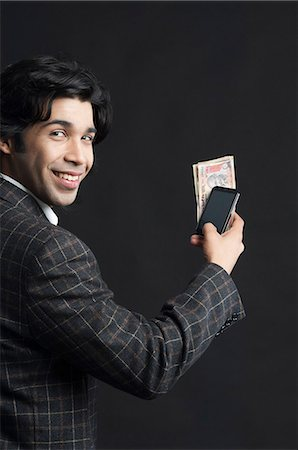 east indian (male) - Mobile banking Stock Photo - Premium Royalty-Free, Code: 630-06724758