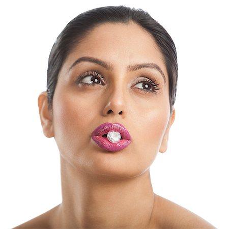diamond - Woman holding diamond between her lips Stock Photo - Premium Royalty-Free, Code: 630-06724796