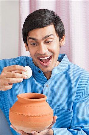 delicious - Bengali man having rasgulla Stock Photo - Premium Royalty-Free, Code: 630-06724877