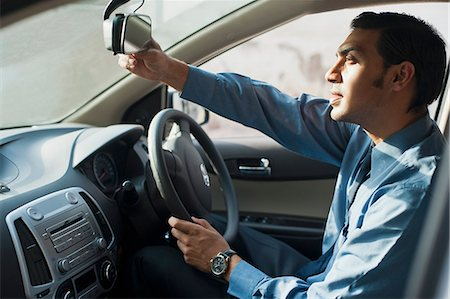 Bengali businessman driving a car Stock Photo - Premium Royalty-Free, Code: 630-06724896