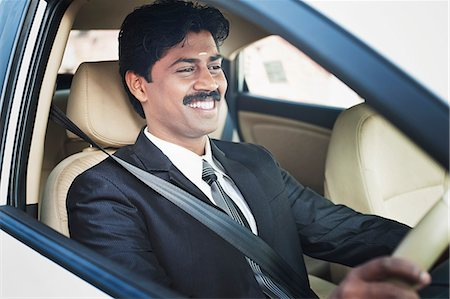 South Indian businessman driving the car Stock Photo - Premium Royalty-Free, Code: 630-06724899