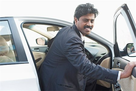 South Indian businessman coming out from the car Stock Photo - Premium Royalty-Free, Code: 630-06724902