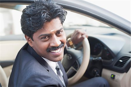 South Indian businessman sitting in the car Stock Photo - Premium Royalty-Free, Code: 630-06724903