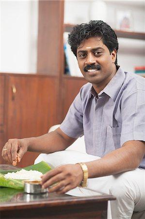 South Indian man having food Stock Photo - Premium Royalty-Free, Code: 630-06724924