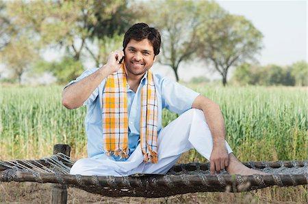farm phone - Farmer talking on a mobile phone in the field, Sohna, Haryana, India Stock Photo - Premium Royalty-Free, Code: 630-06724944