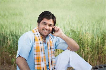 east indian (male) - Farmer talking on a mobile phone in the field, Sohna, Haryana, India Stock Photo - Premium Royalty-Free, Code: 630-06724943