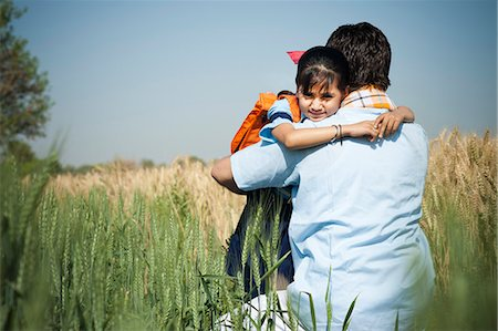Farmer hugging his daughter in the field, Sohna, Haryana, India Stock Photo - Premium Royalty-Free, Code: 630-06724951