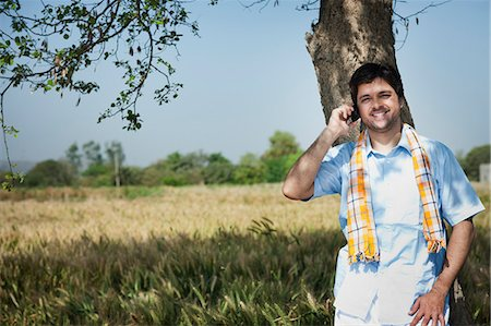 farm phone - Farmer talking on a mobile phone in the field, Sohna, Haryana, India Stock Photo - Premium Royalty-Free, Code: 630-06724963
