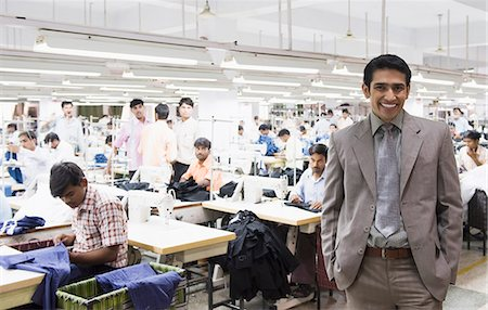 Portrait of a businessman in a textile factory Stock Photo - Premium Royalty-Free, Code: 630-06722252
