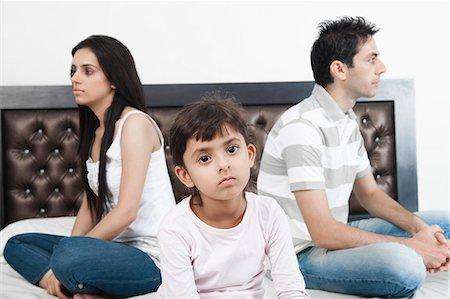 sad child sitting - Family sitting back to back Stock Photo - Premium Royalty-Free, Code: 630-06723103