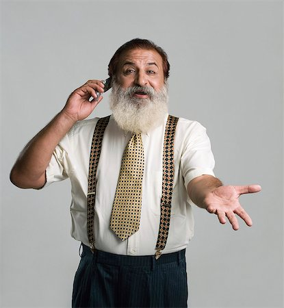Man talking on a mobile phone and gesturing Stock Photo - Premium Royalty-Free, Code: 630-06723284