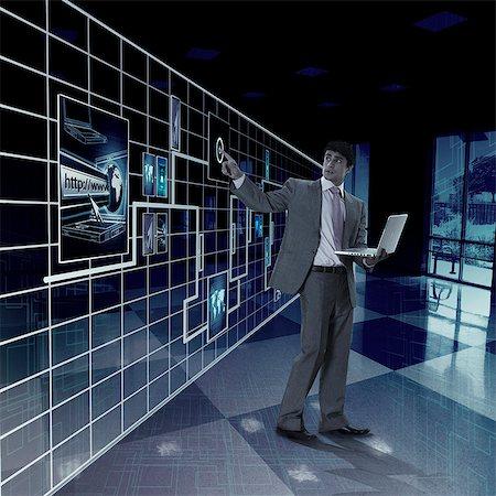 seamless - Businessman working on a virtual screen Stock Photo - Premium Royalty-Free, Code: 630-06723514