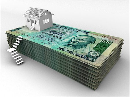 House on top of stack of hundred rupee banknotes Stock Photo - Premium Royalty-Free, Code: 630-06723835